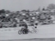 Cycling races behind large motorcycles